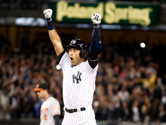 Sept. 25, 2014: Jeter celebrates his walk-off single against the Orioles in his final at-bat at Yankee Stadium.
