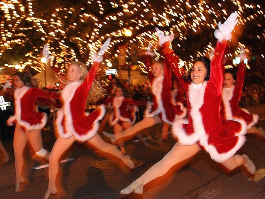 In this file photo, participants in Santa suits pranced down Monroe Street during the Winter Festival parade.