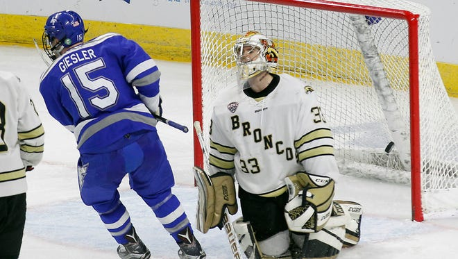 Western Michigan goalie Ben Blacker (33) reacts after letting in a goal during the second period of WMU's 5-4 loss in the NCAA hockey tournament regional semifinal on March 24, 2017, in Providence, R.I.