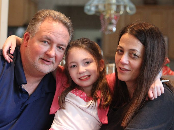Amanda Houser, 10, with her parents, Deane and Maryanne