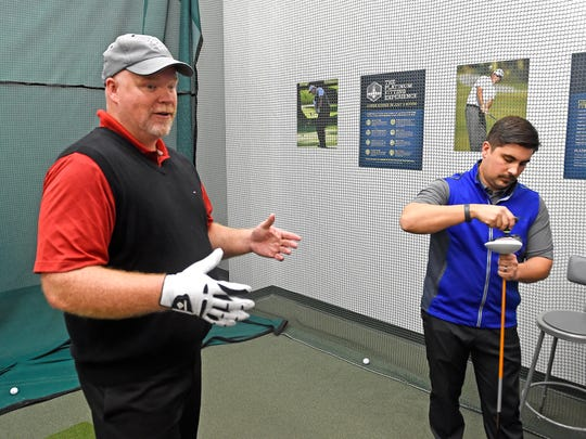 Chad NeSmith gets help with his swing from Stuart Shearin
