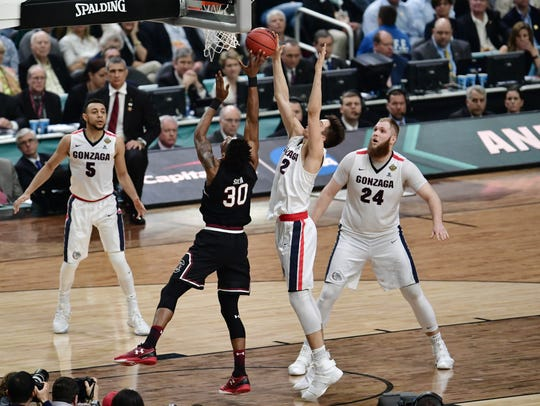 Gonzaga forward Zach Collins defends South Carolina
