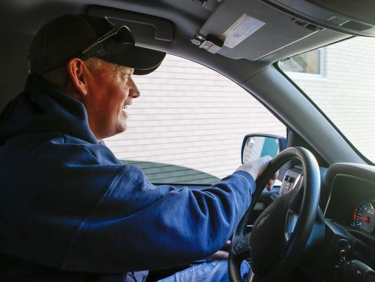 Lyft driver Ryan Farsdale chauffeurs a customer in