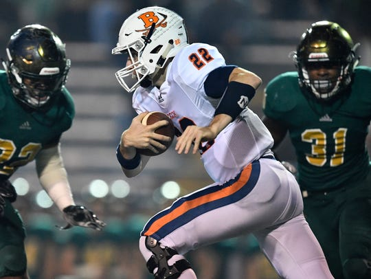 Beech's Nelson Smith (22) gains yards during the first