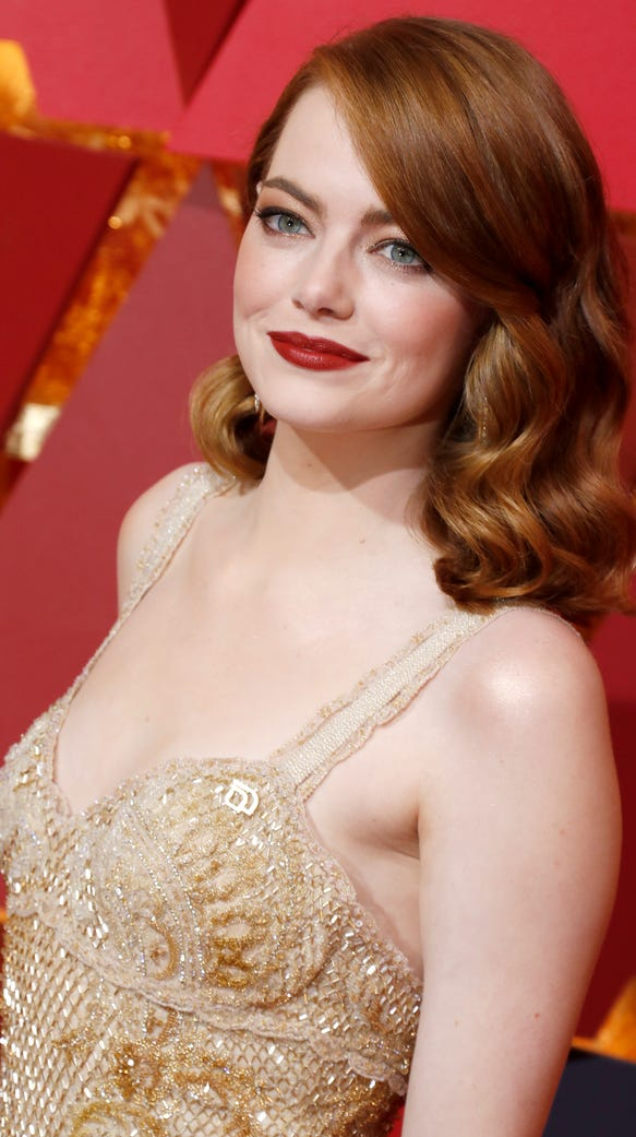 Emma Stone arrives for the 89th annual Academy Awards