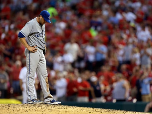 Kansas City Royals starting pitcher James Shields stands on the mound after giving up a solo home run to St. Louis Cardinals' Peter Bourjos during the sixth inning of a baseball game Tuesday, June 3, 2014, in St. Louis. (AP Photo/Jeff Roberson)
