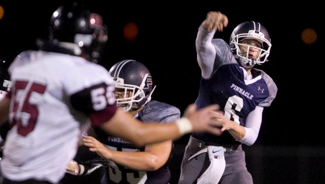 Pinnacle's Brian Lewerke throws a pass against Red Mountain in the third quarter at Pinnacle High School on Aug. 29, 2013, in Phoenix.