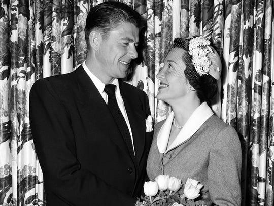 Ronald Reagan and his bride, Nancy Davis, smile at