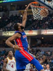 Pistons center Andre Drummond (0) slam dunks the ball