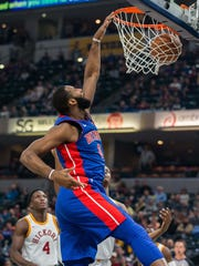 Pistons center Andre Drummond (0) slam dunks the ball in the first quarter on Friday, Nov. 17, 2017, in Indianapolis.