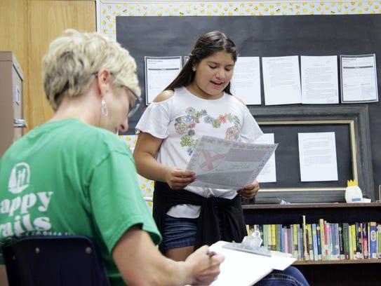 A Frank Kohn Elementary School student reads aloud