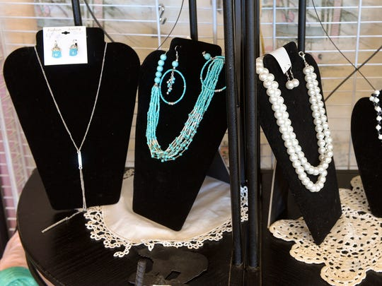 Necklaces and earrings adorn a display Friday, July 22, at Salvage Sisters in Waite Park.