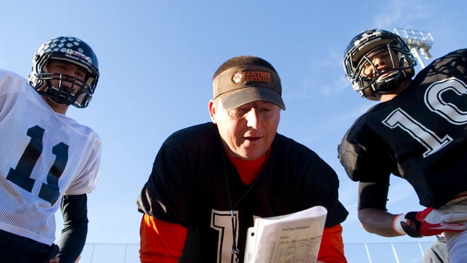 Powell High School football coach Matt Lowe calls out a play during team practice on Wednesday, November 2, 2011. Powell (10-0), the District 3-AAA champion, is facing Anderson County (5-5), who eliminated Powell from last season's Class 5A playoffs.