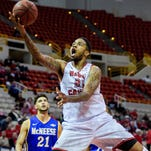UL's Shawn Long (21) attempts a layup in a win over McNeese State earlier this season. He scored his 2,000th career point Saturday vs. Troy
