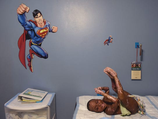 Jayden Georges, 4, of Port St. Lucie laughs with his