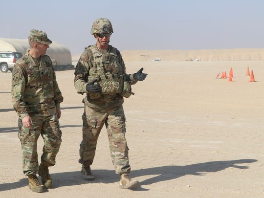 Command Sgt. Maj. Roger W. Hankins, right, with 1st