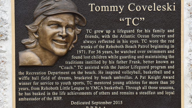 "A plaque dedicated to Tommy Coveleski, a Rehoboth Beach native and 36 year member of the Rehoboth Beach Patrol, was unveiled at the Headquarters on the Boardwalk at Baltimore Avenue on Monday, Aug. 8 with family and many friends in attendance. ""TC"" as he was known, lost a long battle with cancer earlier this year and past beach patrol members and friends got together to purchase the plaque and have it mounted on the building in his honor.  ""TC's"" nieces and nephews did the unveiling as his brother Johnny spoke at the short ceremony."