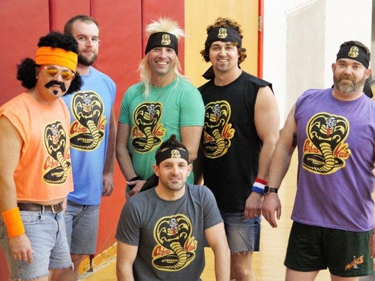 Cobra Kai, a team of U.S. Customs officers, won the award for best 1980s-themed costumes at the Port Huron Police Department's Dodgeball Tournament.