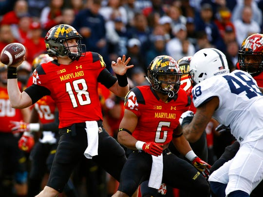 Maryland quarterback Max Bortenschlager (18) throws to a receiver as he is pressured by Penn State defensive end Shareef Miller in the first half of an NCAA college football game in College Park, Md., Saturday, Nov. 25, 2017.