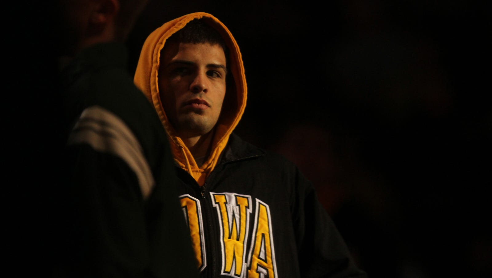 Tony Ramos, former Iowa wrestler and NCAA champion, retires from competition