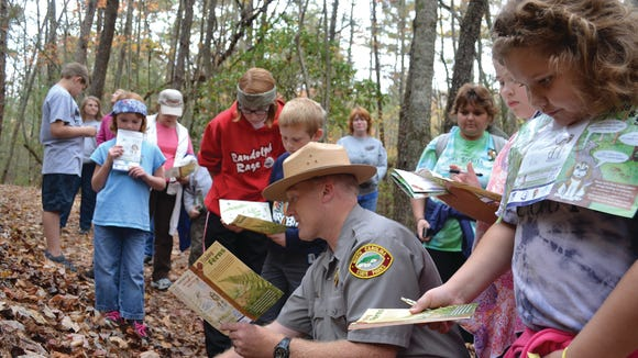 A ranger at Stone Mountain State Park leads a group of children on a TRACK Trail.