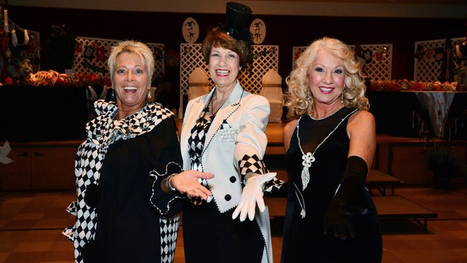 Debbie Brown, Juanita Scott and Barbara Bowes at the Les Harlequins Ball.