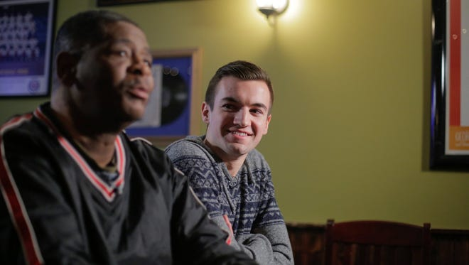 Evan Leedy, right, 19, of Macomb Township and James Robertson, 56, of Detroit, meet for the first time at Mr. B's Pub in Rochester, Mich., on Feb. 2, 2015.