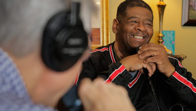 James Robertson laughs while answering questions during a podcast recording at the home of Dick Purtan in West Bloomfield on Tuesday February 3, 2015.