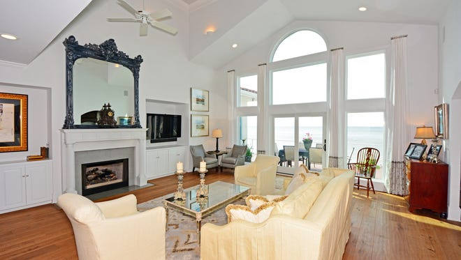 The living room faces Santa Rosa Sound and provides the Bryans with amazing sunset views.