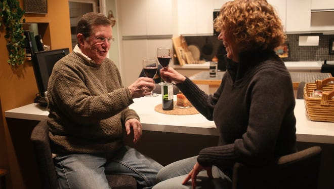 John Hoffmann and his wife, Patricia Hoffmann, both 65, of Brighton enjoy a glass of wine at home on Tuesday, Feb, 10, 2015.  John has suffered from Sleep Apnea for as long as he can remember, and had the robotic surgery procedure, Trans Oral Robotic surgery, performed to correct it  in November of 2013 at St. Joseph Mercy Ann Arbor.
