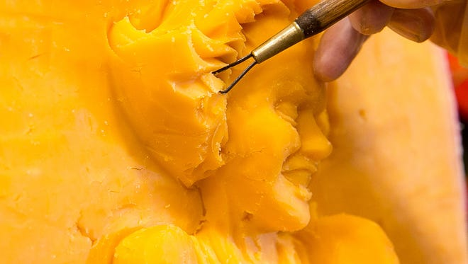 """FILE - """"The Cheese Lady"""" carves the detail of Marilyn Monroe's hair into a block of cheddar."""