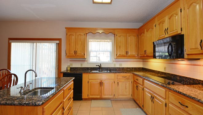 6011 Thistledown Drive, the open kitchen with an island.