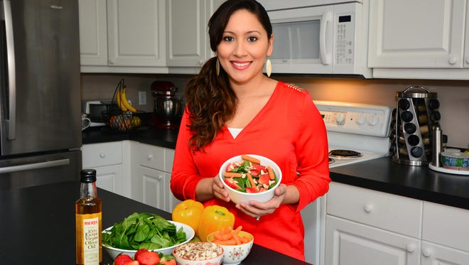 Samantha Walters in the kitchen. Good sources for nutrients include dark green leafy vegetables and carrots.