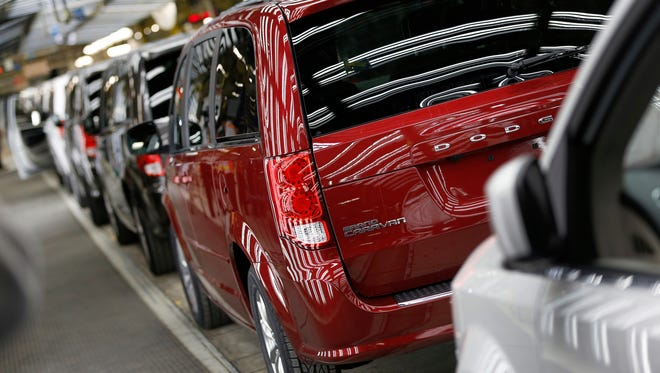 Dodge Grand Caravan come out of the assembly line at Fiat Chrysler Automobiles assembly plant in Windsor, Canada on Monday, February 9, 2015.FCA is investing $2 billion to make the next generation minivan and will close the plant for three months so new tooling and equipment can be installed.The minivan is a core product for the Chrysler brand and the automaker is the No. 1 seller of minivans