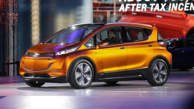 General Motors CEO Mary Barra unveils the Chevrolet Bolt EV, an all-electric concept car, at the North American International Auto Show Monday Jan. 12, 2015. The Bolt has a 200-mile range and has Tesla in its competitive crosshairs. Mandi Wright/Detroit Free Press