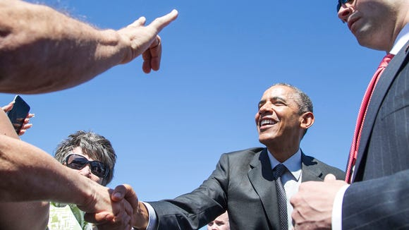 President Obama arrives on Air Force One greeted by