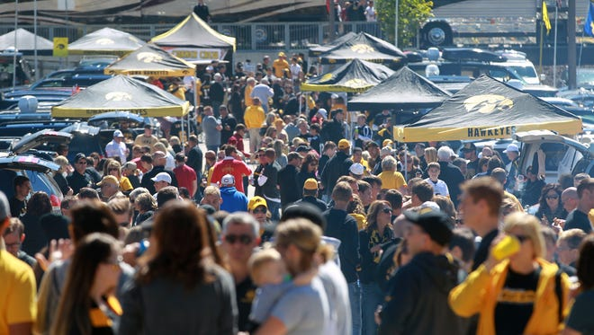 Postgame tailgating hours at Kinnick Stadium will be lengthened by one hour at morning and afternoon games in 2015, the University of Iowa announced on Friday.