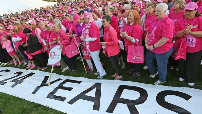Breast cancer survivors gather after the Pink Parade for a giant group photo, before the Susan G. Komen Race for the Cure in downtown Indianapolis, Saturday, April 18, 2015.