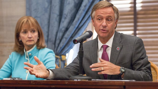 Republican Gov. Bill Haslam speaks about the conclusion of the legislative session at a news conference at the state Capitol in Nashville, Tenn., on Thursday, April 23, 2015. At left is House Speaker Beth Harwell, R-Nashville. (AP Photo/Erik Schelzig)
