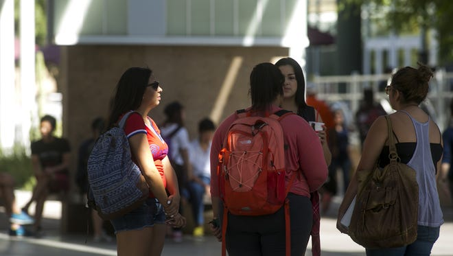 Arizona State University Students walk on the main campus April 10, 2015, in Tempe.