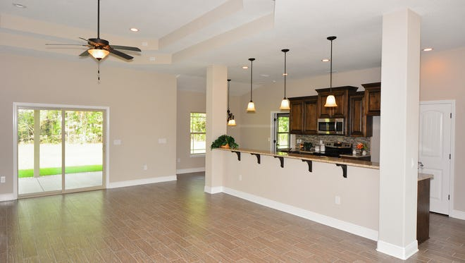 Merging kitchen and living areas allows homeowners to interact easily with their guests.