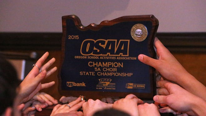 Corvallis High School students celebrate winning the 5A OSAA State Choir Championships awards at George Fox University on Friday, May 8, 2015, in Newberg, Ore.