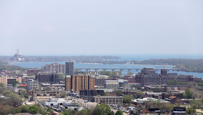 View looking east towards the McArthur Bridge to Belle Isle from the First National building in Detroit on May 8. According to estimates released by the U.S. Census Bureau, Detroit continues to lose residents.