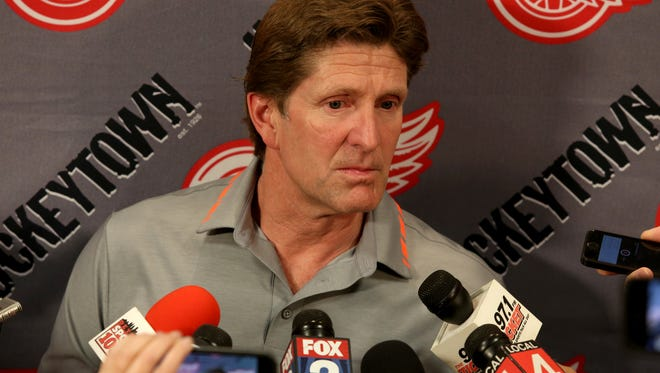Former Detroit Red Wings hockey coach Mike Babcock, who was hired by the Toronto Maple Leafs earlier this week, talks to the media in the teams locker room at Joe Louis Arena in Detroit on Friday, May 22, 2015.