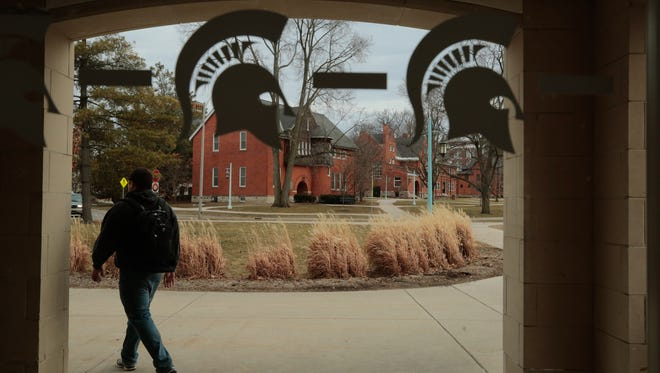 Spartan logos are seen on a window from a parking garage on the Michigan State University campus in East Lansing on Monday March 16, 2015.