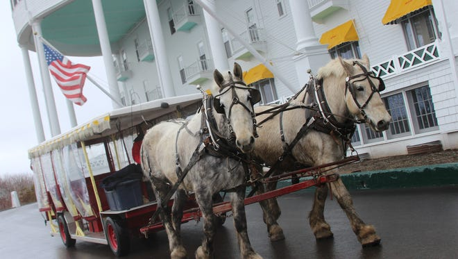 Horse and buggy pictured in front of the Grand Hotel on Mackinac Island.