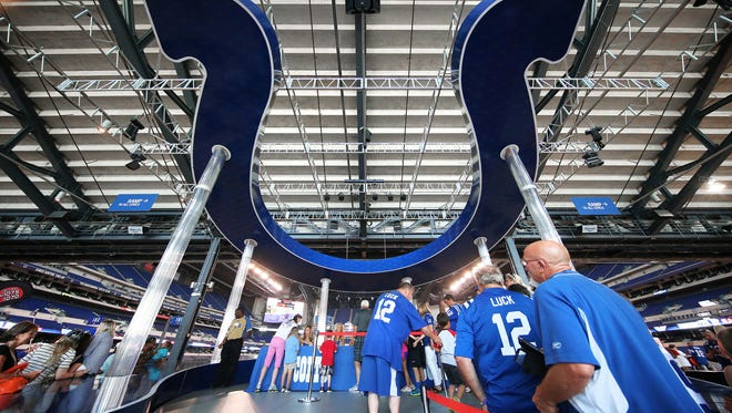 Fans get a close look at decorations inside Lucas Oil Stadium during Colts minicamp. June 9, 2015