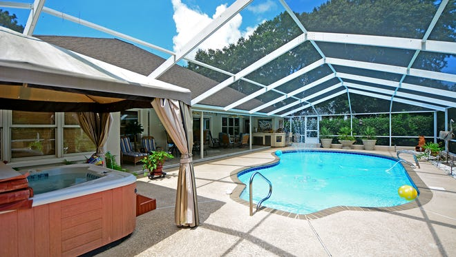 3600 Tibet Drive, the screen enclosed pool deck is perfect for summer parties.