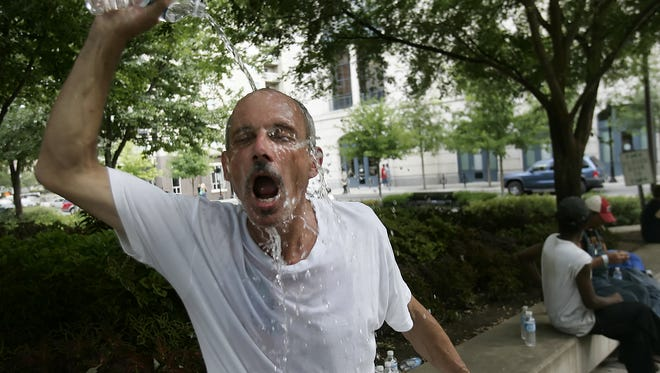David Kineski cools himself off on a hot Nashville day.