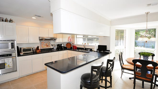 4305 D'Evereaux Drive, the kitchen features abundant storage and seating.